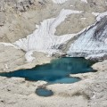 Veduta aerea del ghiacciaio della Fradusta e del suo laghetto morenico situato nell'altopiano delle Pale di San Martino - Fradusta Glacier, Aerial view of the glacier and its morainal lake in the Pale di San Martino plateau.